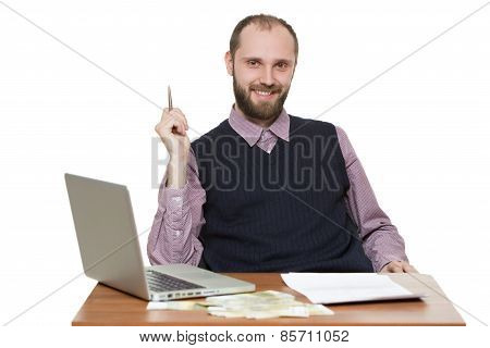 businessman in front of his desk and laptop