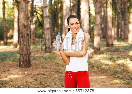 Young Woman Taking A Break After Running