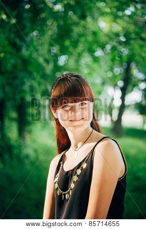 Young Happy Beauty Red Hair Girl In Nature In Summer