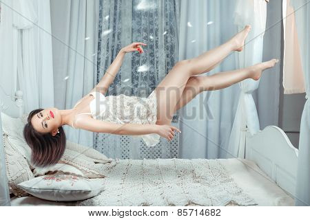 Cute Girl Hovers Over The Bed.
