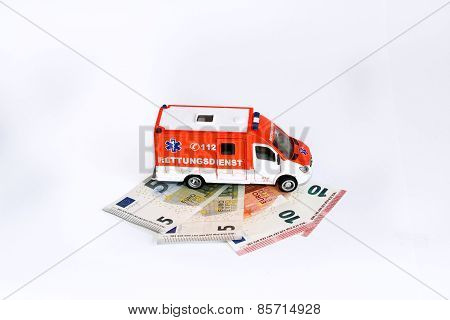 Cost of health care: Ambulance car with Euro money concept