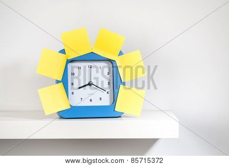 Many sticky notes stuck on the big clock