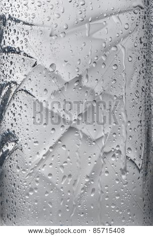 Close up water droplets on drinking water bottle