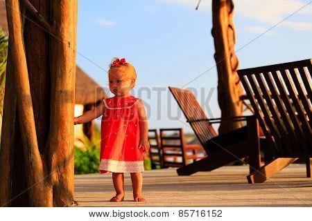 cute little girl walking in tropical resort
