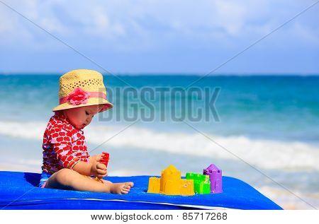 cute little girl  with sand toys on the beach