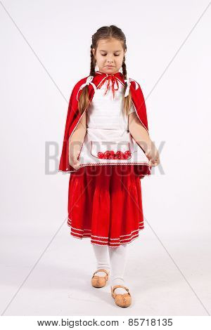 Little Girl In Costume Looking Into The Distance