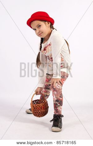 Little Girl Holding A Basket In Her Hand