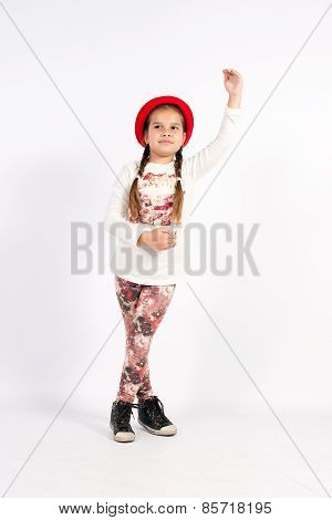 Little Girl Dance With A Red Hat With Hand In Front Of You,