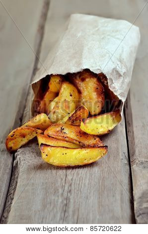 Fried Potato Wedges In Paper Bag