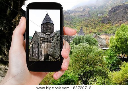 Tourist Photographs Geghard Monastery In Armenia