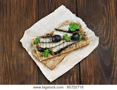 Fish Sandwich With Sprats And Olives