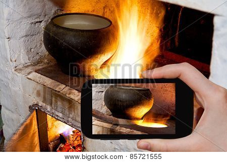 Tourist Photographs Of Russian Stove And Iron Pot