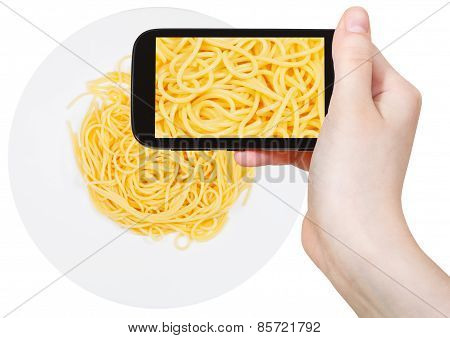 Tourist Photographs Of Spaghetti Al Burro On Plate