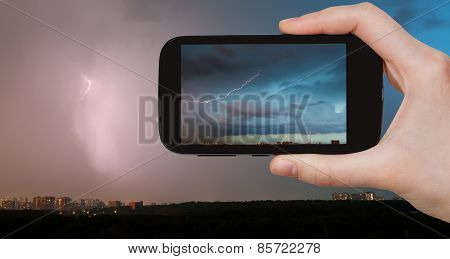 Tourist Photographs Of Lightning Bolt Over City