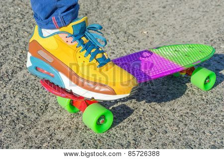 Leg Skateboarder On A Colorful Skateboard.