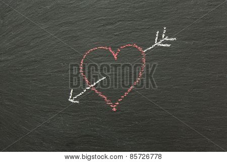 Chalk Heart With Arrow Drawn On A Chalk Board.