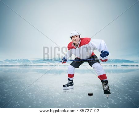Young male hockey player on the ice