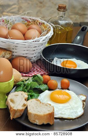 Fried Eggs With Bread And Oil