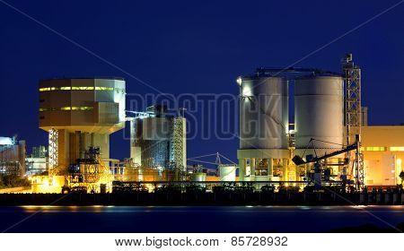 power station at night with smoke , hong kong