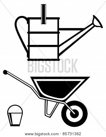 Garden wheelbarrow and watering can