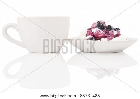 White Cup Of Coffee And Curd Dessert On The Glass With Reflection
