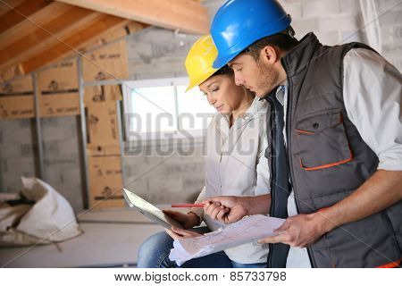 Young woman in professional training on building site