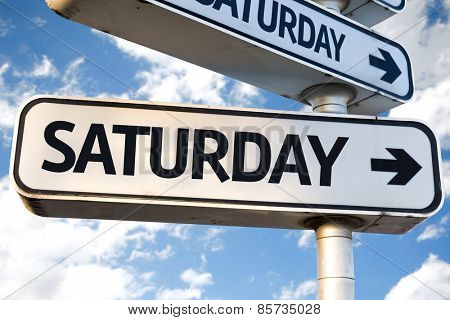 Saturday direction sign on sky background