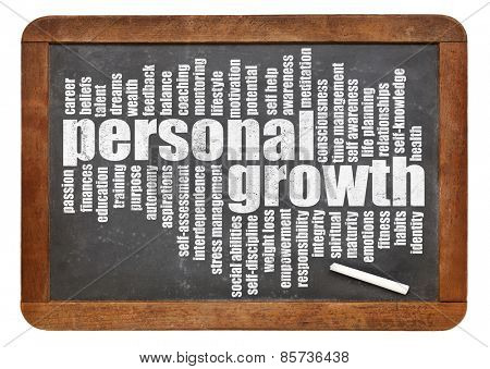 personal growth word cloud on a slate blackboard isolated on white
