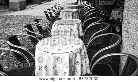 Bar tables in Portofino, wintertime. Black and white photo
