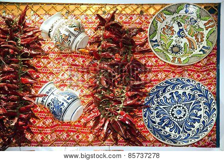 Artistic Traditional Folk Art Objects And Red Hot Spicy Organic  Paprika On Market Stall
