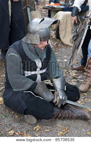 ZAGREB, CROATIA - OCTOBER 07, 2012: Knight sitting on the ground, resting from the fight at