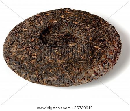 Disc of chinese puer tea on white background