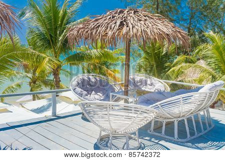 lounge area on tropical beach background