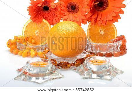 Still life with cheerful orange juicy oranges and flowers gerbera