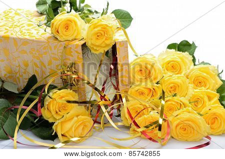 Bouquet of yellow roses and gift box with lacy thing inside