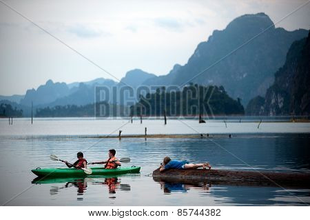 Tourists Fun Canoeing In Cheow Larn Lake (ratchaprapa Dam),Thailand.