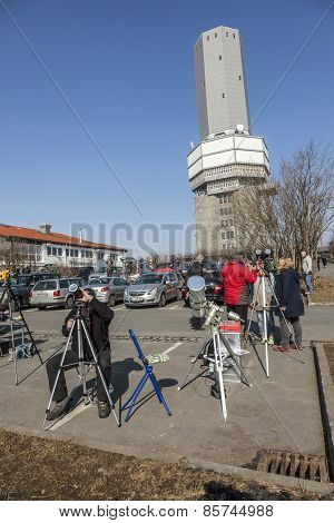 People Watch The Partial Eclipse At The Feldberg