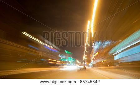 Night blurred city lights of streets and moving cars