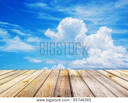 Perspective View To Sparse White Clouds In The Blue Sky And Background Of Wood Floor Texture.