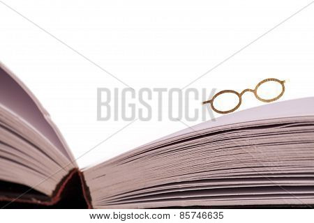 Reading Glasses On Book Edge