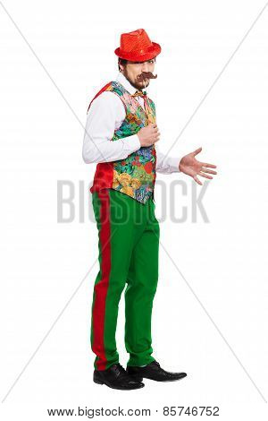 Portrait of funny man holding fake mustache on stick at mouth dressed in disco retro style