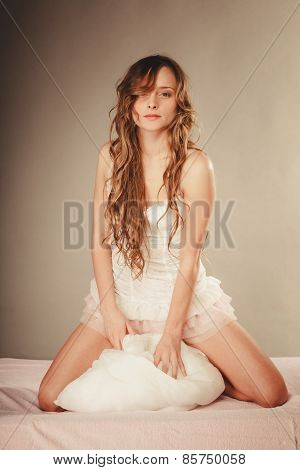 Woman Long Curly Hair Relaxing On Her Bed At Morning