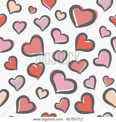 Seamless pattern with pink freehand hearts