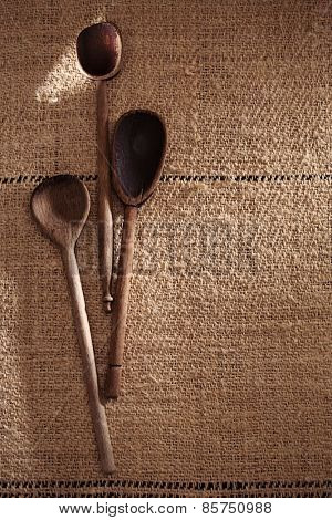 real vintage wooden spoons on old grain sacking linen Completely hand made  handwoven and homespun
