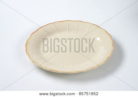 cream decorative plate on white plate