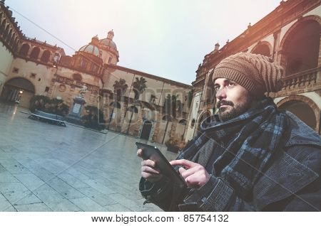 Young Hipster Sendig E Mails Outdoors Warm Filter Applied
