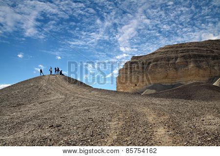 Tourists In A Rocky Desert
