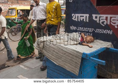 Boy Sleeping On The Street