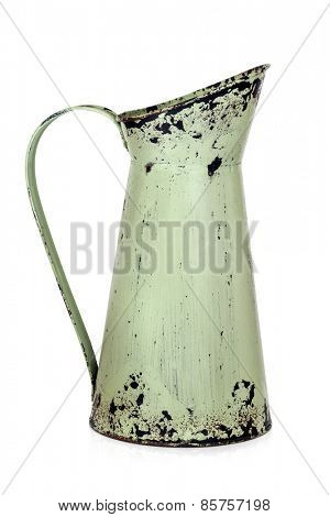 Shabby chic retro metal jug isolated on white.