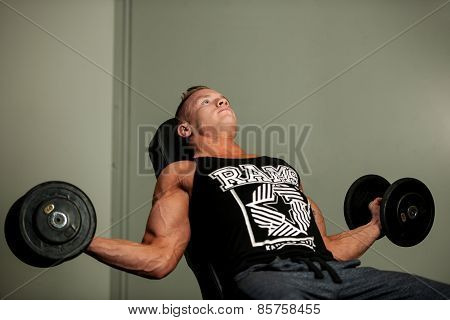 Hnadsome Young Man Working Out With Dumbbells In Fitness -  Power Training